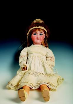 A doll with a porcelain head