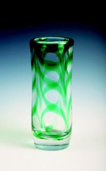A vase of a heavy crystal glass with green stripes